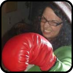 Woman Punching Mirror With Boxing Gloves
