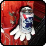 Life Sized Asian Doll With A Can Of Pabst Blue Ribbon In Her Hand