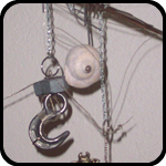 Mobile With Giant Hook, Twigs, Shell, Pewter Lamb, Chimes, Wire, and a Locket
