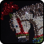 Carnival horse made of sequins on black velvet