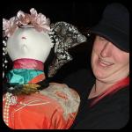 Jo Jo Carrying a Heavy Asian Doll Statue