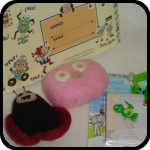 Babs sent the cutest package with the felted toys -- little plastic pieces that